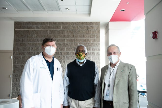Mayor George McGill joins volunteers at the Fort Smith vaccine clinic on Feb. 24.