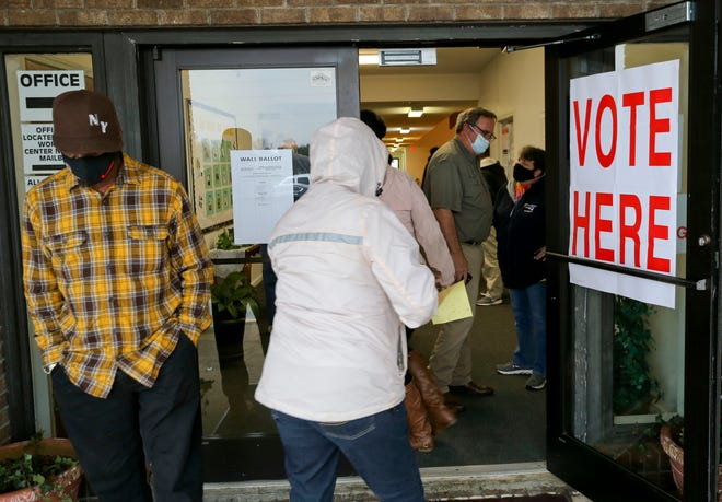 Voters enter the East McFarland Baptist Church polling station to cast votes in the Tuscaloosa municipal election Tuesday, March 2, 2021. [Staff Photo/Gary Cosby Jr.]