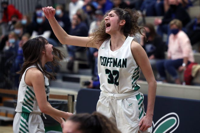 Coffman's Veronica Baldridge (right) and Kenzie Bicking cheer on their teammates in the waning minutes of a 37-28 win over Marysville in a Division I district final Feb. 27. The Shamrocks played Newark in a regional final March 5.