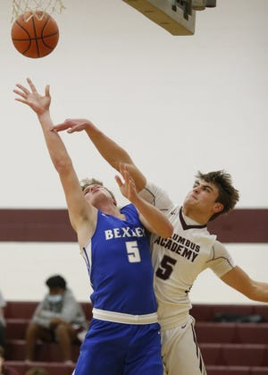 Columbus Academy's Brady Hess attempts to block a shot by Bexley's Will Cordle earlier this season. Hess led a five-player senior class for the Vikings, who finished 16-8.