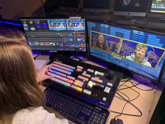 Gahanna Lincoln High School senior Kortney Grimm, technical director, prepares in the Lincoln Live control room for an episode of the Lincoln Sports Zone with anchors Audrey Paquette and Evan Henry.