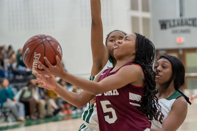 Red Oak's Breanna Davis (5) moves inside during a game against Waxahachie. The Class 5A No. 19-ranked Lady Hawks' season ended in the 5A Region II semifinals with a 65-60 overtime loss to No. 12 Wylie East on Friday night.