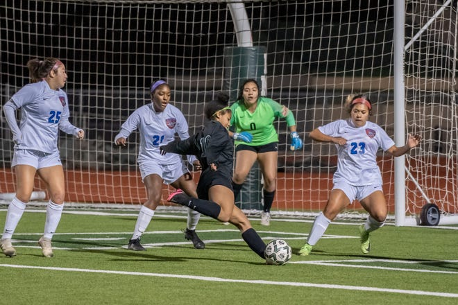 Waxahachie's Amiyah Carter (10) takes aim at the goal during a home match against Duncanville on Feb. 5. The Lady Indians picked up back-to-back shutout wins over Cedar Hill and DeSoto and were scheduled to play at Duncanville on Tuesday night in a game with playoff implications.