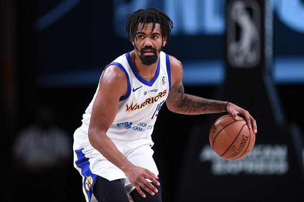 Jacob Evans #15 of the Santa Cruz Warriors handles the ball against the Erie BayHawks on March 2, 2021 at AdventHealth Arena in Orlando, Florida.