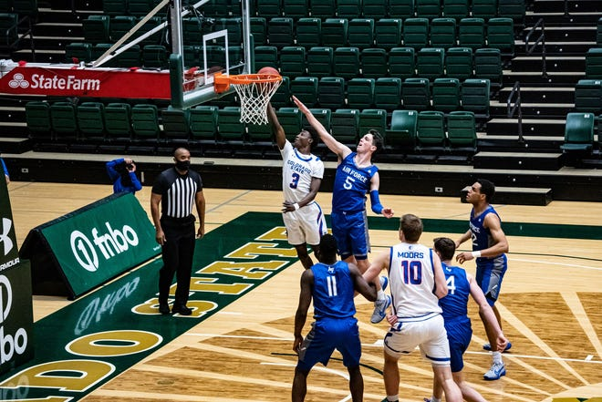 Colorado State basketball player Kendle Moore goes for a layup in a game against Air Force on Monday, March 1, 2021.