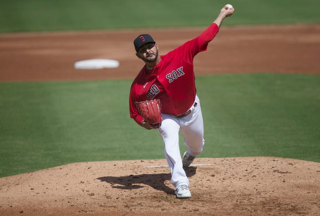 Martin Perez pitches during a spring training game against the Tampa Rays at Jet Blue Park in Fort Myers on Tuesday March, 2, 2021.