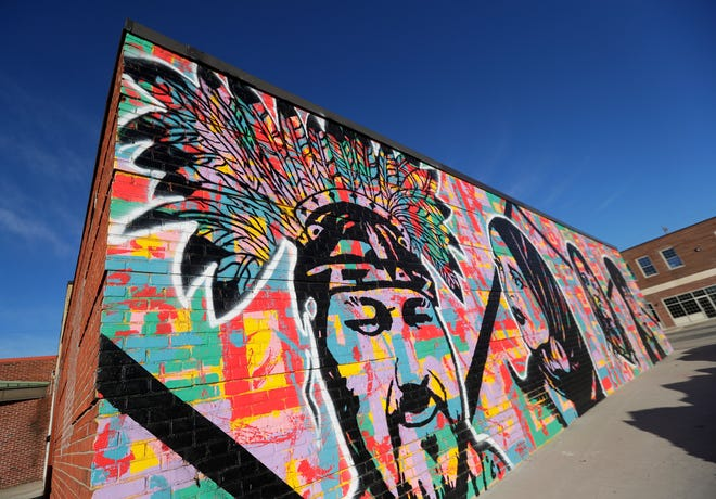 """The mural """"Unity,"""" by Egypt Hagan on Main Stree in Green Bay."""
