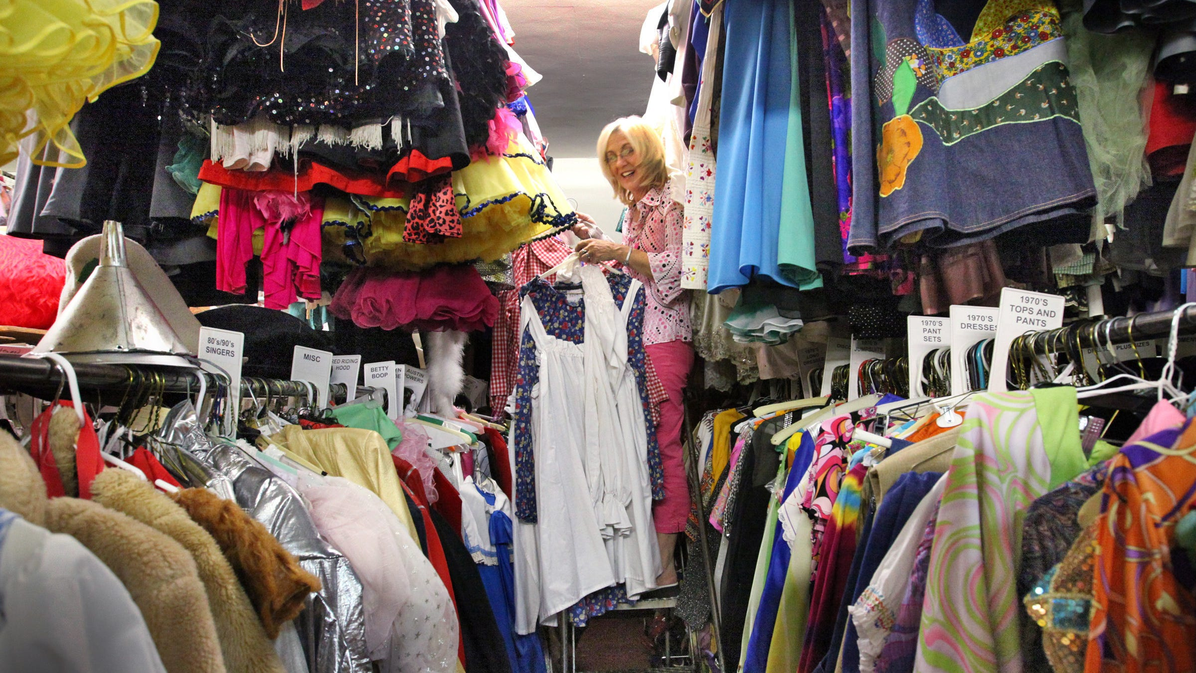 Owner and operator of Costumes by Margie, Cheryl Harmon, within just a small portion of her huge costume inventory at 3818 North Illinois. The costume shop, which had a loyal following, closed during the novel coronavirus pandemic.  IndyStar file photo (Frank Espich/The Star)