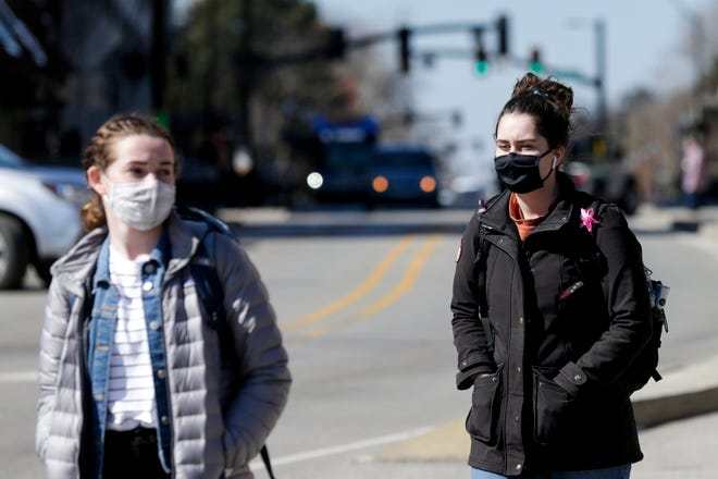 Pedestrians cross the intersection of Northwestern Avenue and State Street, Tuesday, March 2, 2021 in West Lafayette.