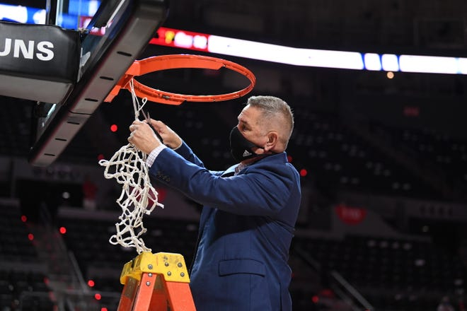 UL women's basketball coach Garry Brodhead cuts down a net after the Ragin' Cajuns beat Little Rock on Saturday at the Cajundome to claim their first conference championship in program history.