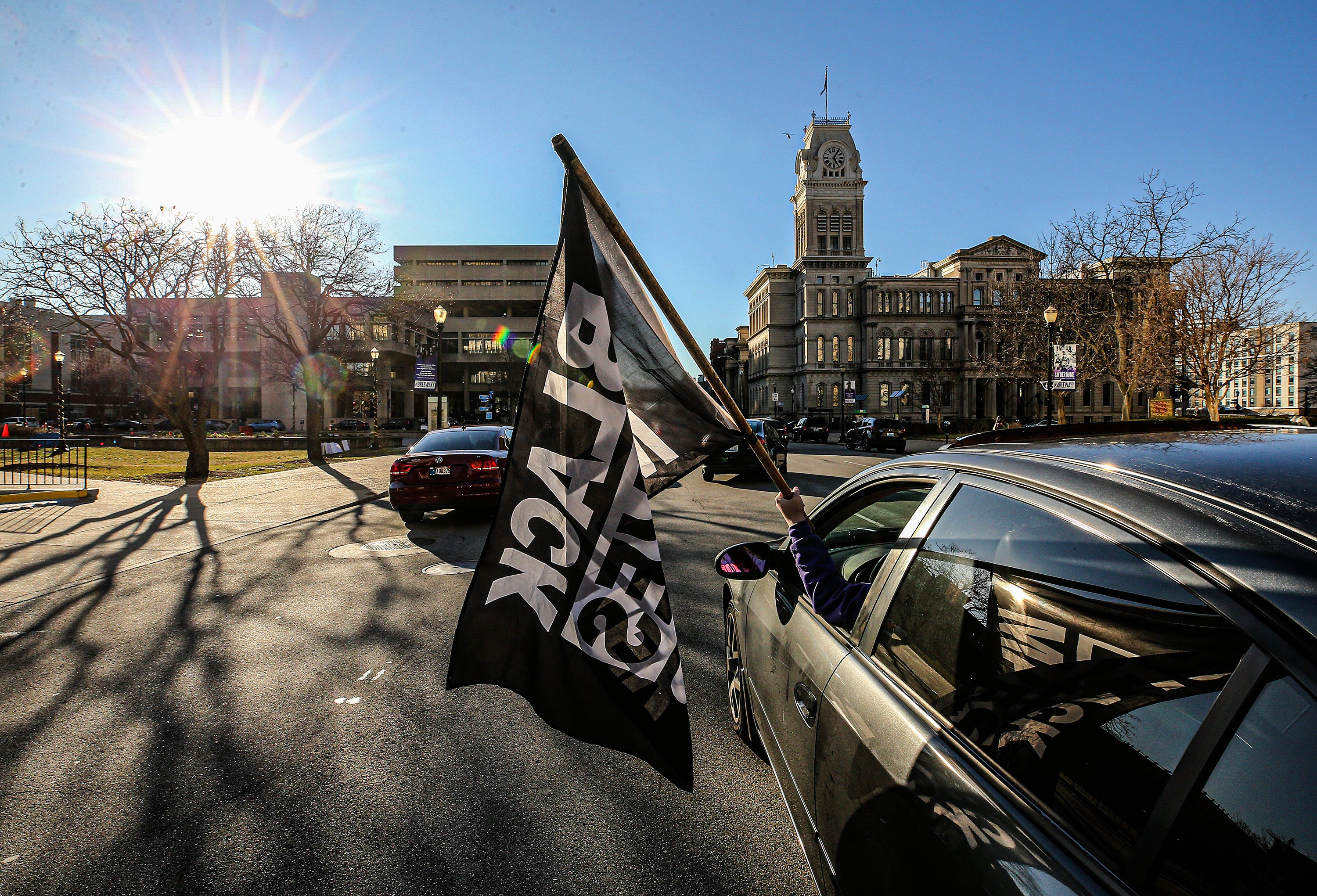 Cars gather on Jefferson Street to caravan to Frankfort for Breonna Taylor on Tuesday, March 2, 2021