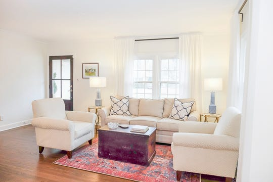 The living room has a bright and airy feel to it.