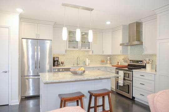The kitchen has several upgrades that were added by a previous owner; quartz and granite countertops, custom cabinetry, and stainless steel appliances.
