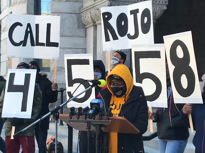 Calena Roberts, Wisconsin field director of SEIU, speaks at a rally on Tuesday to push Sen. Ron Johnson to support an increase in the minimum wage.