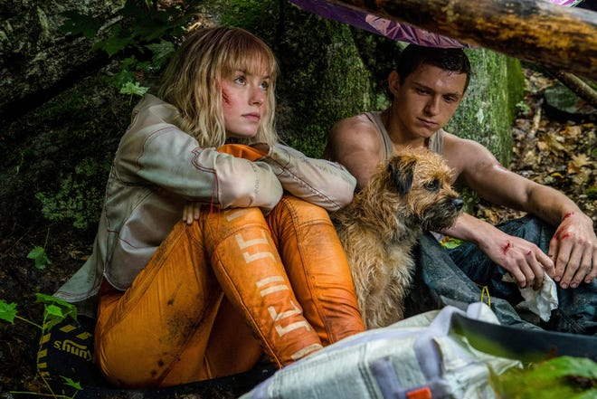 """Daisy Risley, left, and Tom Holland, right, brace for battle """"Chaos Walking."""""""