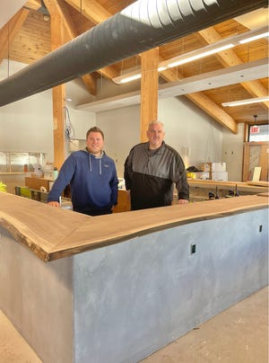 Storm Family Group is the new owner for Menomonee Falls' Wanaki Golf Course.Scott Schaefer of Storm Family Group, left, pictured with general manager Jim Ehnert, said the newly remodeled clubhouse will have a full beverage menu and new food offerings.