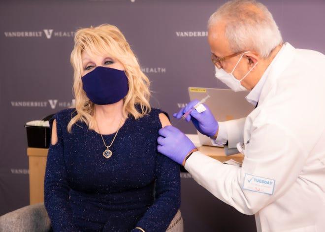 Dolly Parton receives a dose of Moderna COVID-19 vaccination from Dr. Naji Abumrad at Vanderbilt Heath on March 2, 2021, in Nashville, Tenn.
