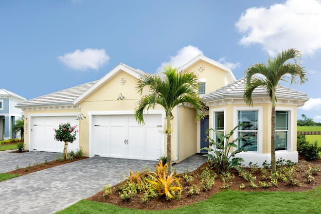 The Fresia villa model from Minto's Buttonwood Collection is 2,456 total square feet with 1,862 square feet under air. It includes three bedrooms, two baths and two-car garage.