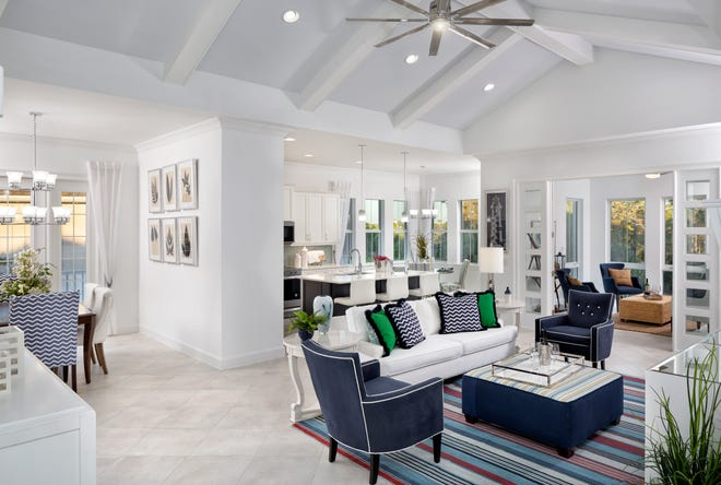 The Hibiscus Retreat coach home model at The Isles of Collier Preserve is 3,396 total square feet with 2,733 square feet under air. It includes three bedrooms, three baths, den, sunroom, retreat and two-car garage.