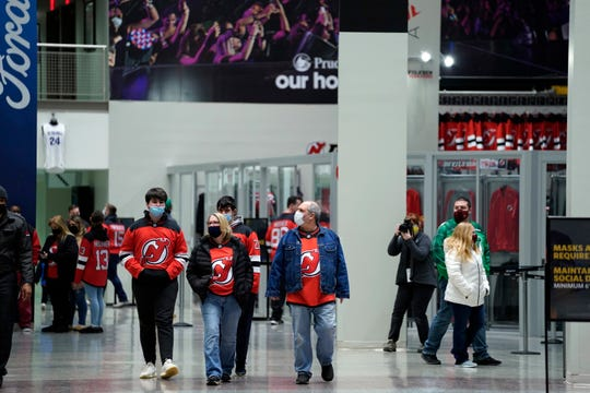Fans return to the Prudential Center for a regular season game between the New Jersey Devils and the New York Islanders on Tuesday, March 2, 2021, in Newark.