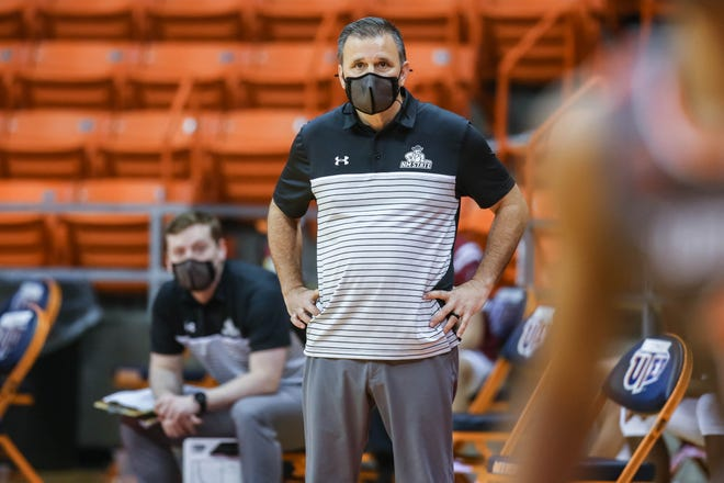 Head coach Chris Jans stands on the sidelines as the New Mexico State Aggies faces off against the UT Rio Grande Valley Vaqueros at UTEP's Don Haskins Center in El Paso on Tuesday, March 2, 2021.