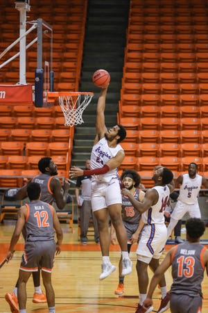 William McNair (24) dunks as the New Mexico State Aggies face the UT Rio Grande Valley Vaqueros at UTEP's Don Haskins Center in El Paso on Tuesday, March 2, 2021.