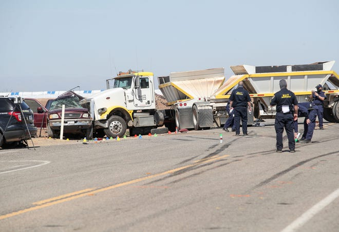 Investigators work the scene of a two vehicle crash that killed at least 15 people on Highway 115 near Holtville, Ca., March 2, 2021.