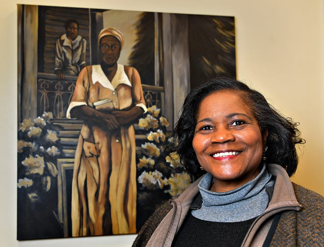 Artist Ophelia M. Chambliss, of Manchester Township, is photographed with her painting of Hester Oliver which is on display at York College Center for Community Engagement in York City, Tuesday, March 2, 2021. Chambliss will be opening an exhibit, which will include the painting of Oliver, at York County History Center in June.  Dawn J. Sagert photo