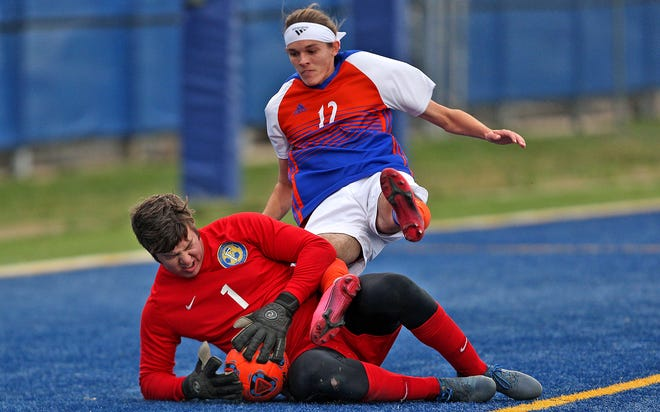 Central's Morgan McDonald, center, trips over the goalkeeper during a game against Frenship on Monday, March 1, 2021.