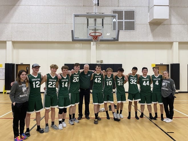 The San Angelo Cornerstone Christian School boys basketball team poses for a team photo following a 53-52 overtime win against Houston Southwest Christian Tuesday, March 2, 2021, in Sugar Land.