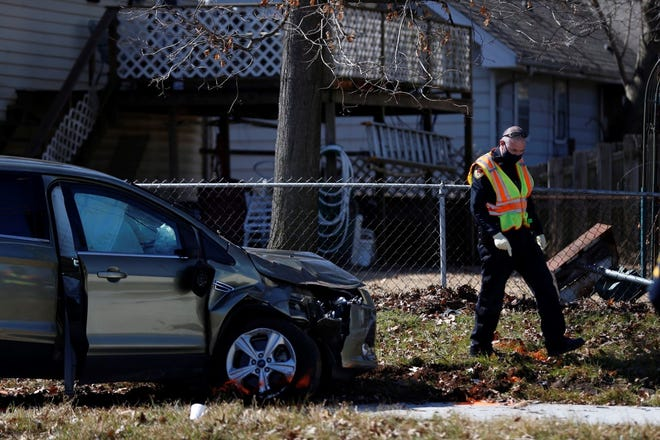 Police crews work the scene of a traffic crash near Sunset Street and Fremont Avenue on Tuesday.