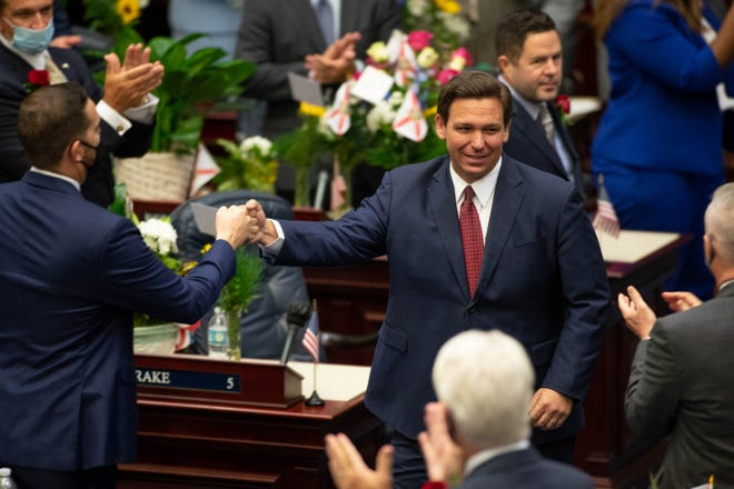 Gov. Ron DeSantis arrives in the House of Representatives chamber to give his State of the State speech on the first day of the 2021 Legislative Session on Tuesday.