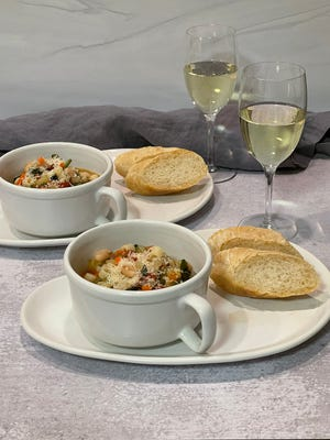 Serve minestrone with a sprinkling of freshly grated Parmesan cheese on top, and a freshly baked baguette on the side.
