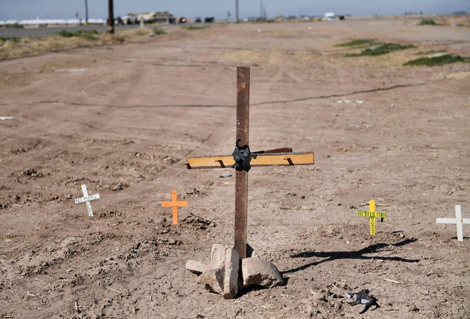 Crosses are seen near the scene of a crash between an SUV and a semi-truck full of gravel near Holtville, California on March 2, 2021.