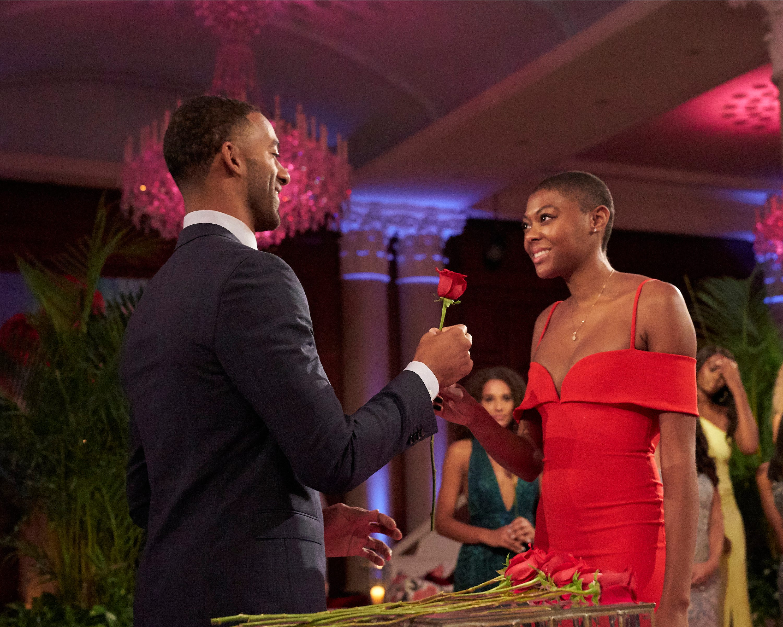 Contestant Chelsea Vaughn accepts a rose from Bachelor Matt James.