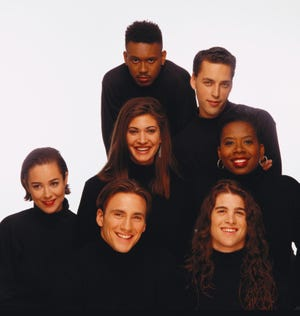"The inaugural cast of 'The Real World' - Kevin Powell, top clockwise, Norman Korpi, Heidi B. Gardner, Andre Comeau, Eric Nies, Beck Blasband and Julie Gentry, center, as seen in 1992, reunites in 'The Real World Homecoming: New York"" on Paramount+."