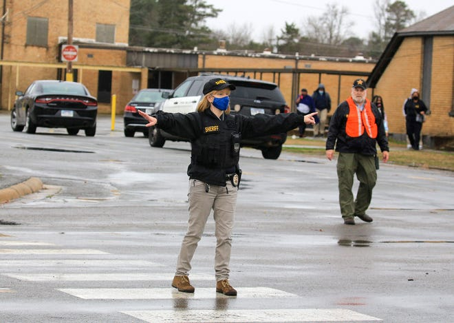 Law enforcement officials direct traffic outside Watson Chapel Junior High School in Pine Bluff, Ark., on Monday after one student was shot and seriously injured inside the school.