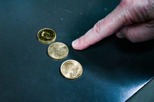 """Gold coins inside of Wilshire Coin, a precious metals and rare coins store in Santa Monica, California. Owner Glenn Sorgenstein said demand for precious metals has boomed since the pandemic began. """"The public had a craving for metal,"""" he said. """"They wanted something that was more secure than holding U.S. dollars or being invested in the stock market, so things changed dramatically in March of 2020."""""""