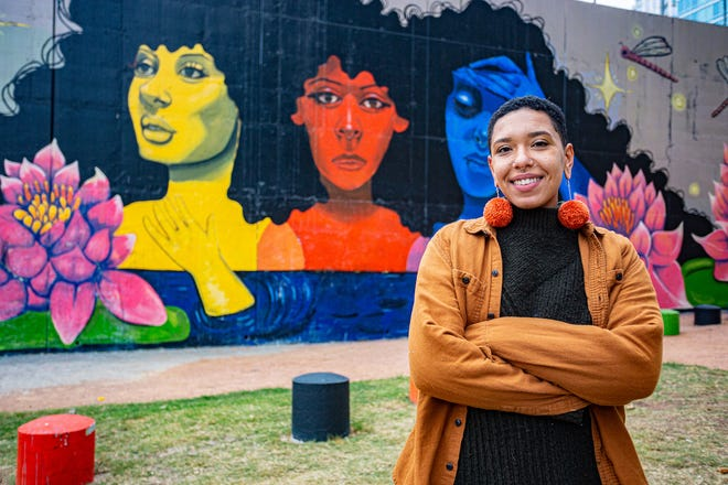 "Sadé Lawson with her mural, ""It's OK to Not Be OK,"" which is located at 115 Sandra Muraida Way"