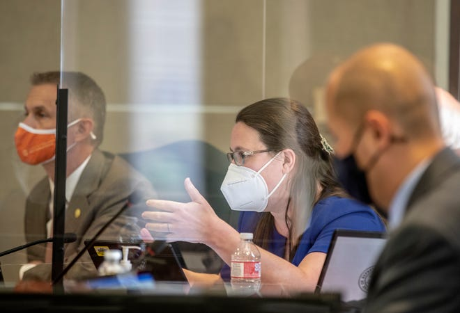 Texas state Rep. Erin Zwiener, center, questions  Dr. John Hellerstedt during a video hearing about Gov. Greg Abbott's decision to end the statewide mask mandate aimed at stopping the spread of the coronavirus.