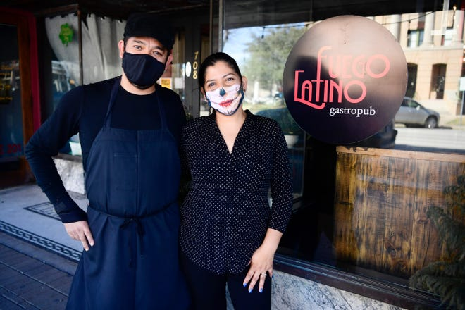 Jorge and Aracely Alcoer, owners of Fuego Latino Gastropub, pose for a photo outside their Georgetown restaurant. They plan to keep their restaurant at 50% capacity and are still requiring masks for servers and customers, despite Gov. Greg Abbott rescinding the statewide mask mandate.