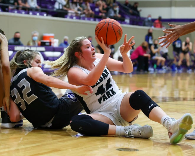 Shelby Hayes secures a loose ball for Cedar Park against Georgetown in the first half of a Class 5A regional final Tuesday at Liberty Hill High School. Cedar Park held Georgetown scoreless during two of the four quarters to advance to state by a final of 44-12.