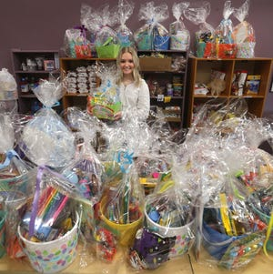 Nordonia High School senior Grace Renier, 18, with some of the 185 Easter Baskets she made for the Emergency Assistance Center.