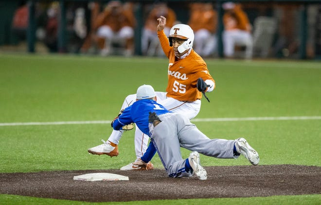 Texas infielder Cam Williams is tagged out by Texas A&M-Corpus Christi second baseman Itchy Burts during the Longhorns' 12-1 win Tuesday night at UFCU Disch-Falk Field. Texas improved to 4-4.
