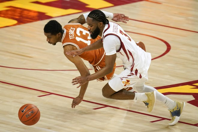 Texas guard Jase Febres fights for a loose ball with Iowa State guard Tre Jackson during the Longhorns' 81-67 victory Tuesday night in Ames, Iowa. Febres, who has battled a slow comeback from knee surgery last year, had his best game of the season.