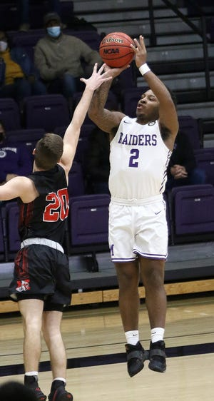 Mount Union's Collen Gurley, right, puts up a 3-point shot attempt guarded by Muskingum's Noah Begue during OAC tournament action at Mount Union Tuesday, March 2, 2021.