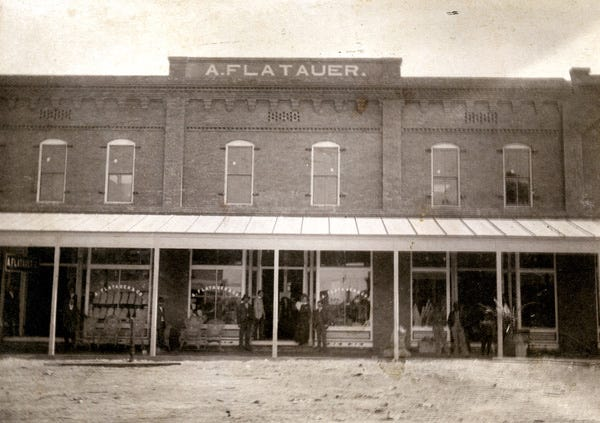 Front of the A. Flatauer & Co. clothing and dry goods store in Apalachicola, across from the Dixie Theatre on Avenue E, taken in the early years of the 20th century
