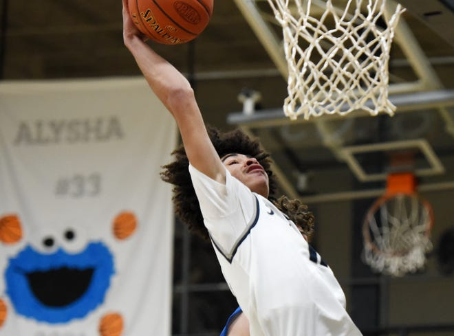 Rochester's Devon Hemer attempts a dunk during Tuesday night's WPIAL playoff game against West Greene at Rochester.