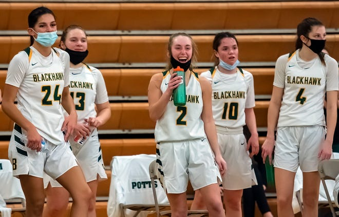 Blackhawk's Kassie Potts, center, and her teammates are tired but happy after their decisive win over Highlands Tuesday at Blackhawk High School.