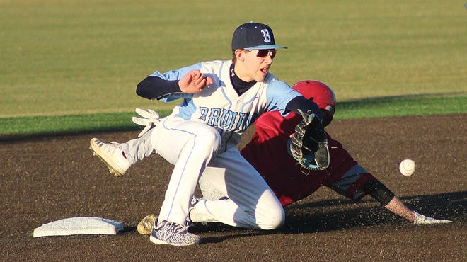 A Bartlesville High jayvee infielder waits for ball while a Dewey baserunner closes in on second base during Tuesday's showdown at Doenges Stadium.